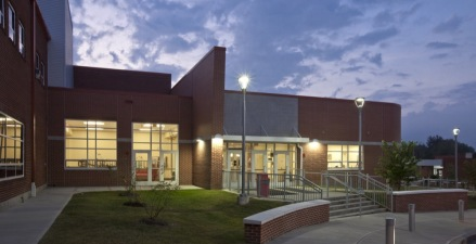 The new two-story math and science wing addition, created the opportunity to significantly change the appearance of the school, by creating a new entrance and entry lobby.