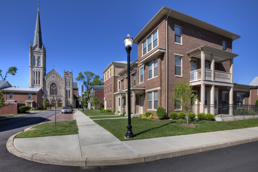 The wide range of housing types includes a mix of single family detached homes, attached homes, and small apartment buildings. The variety of housing types creates a diversity of scale and style along the neighborhood streets.