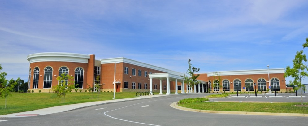 The design of the new Glasgow High School was phased around an existing classroom building, gymnasium building and separate band/vocational tech building to provide the opportunity to connect the disjointed buildings, and create a high performance, energy efficient campus worthy of LEED® certification.