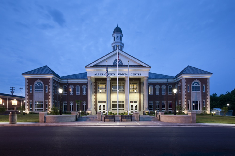 Allen County Judicial Center features an octagonal cupola incorporating four illuminated clocks and an open belfry featuring the original bell from the old courthouse.
