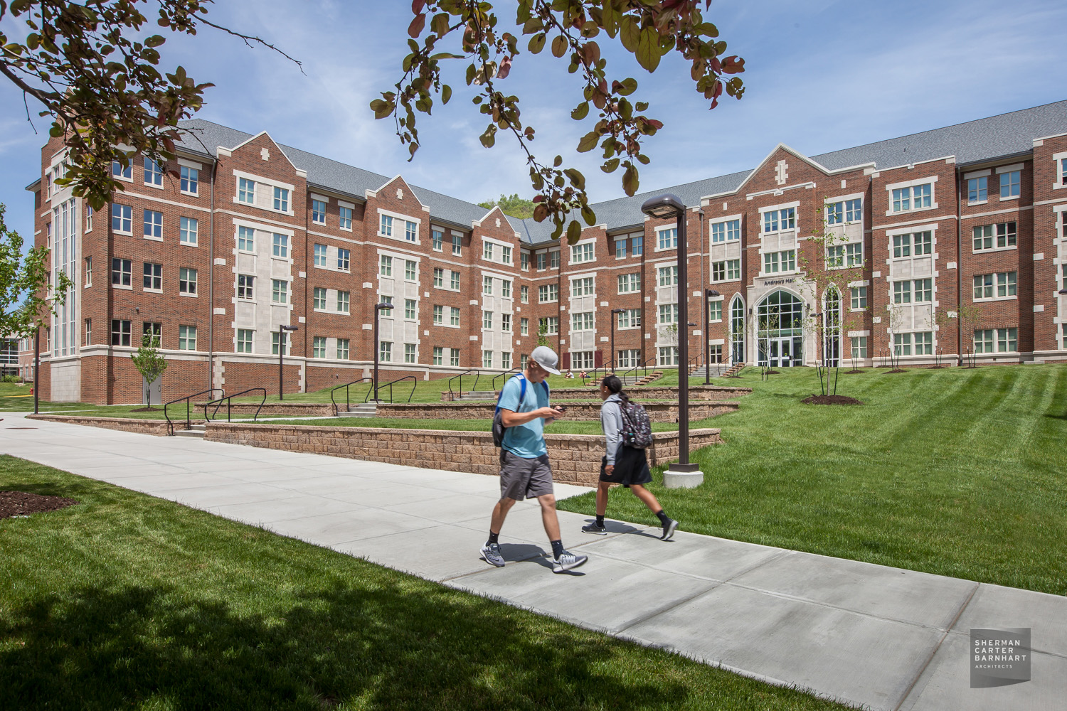 The brick and limestone exterior is designed in the collegiate gothic style to enhance the existing campus architecture.