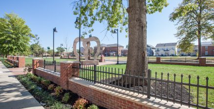 "The new neighborhood featuring a fitness park , and the ""Park Block"" features the ""boxing glove"" sculpture in tribute to Louisville native, Muhammad Ali."