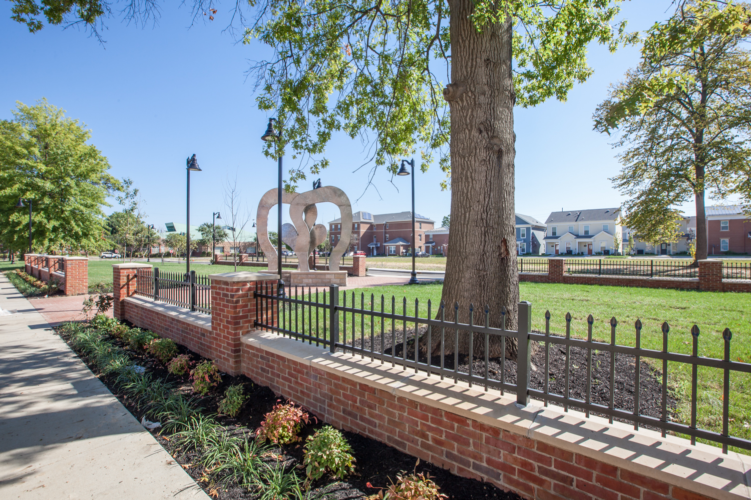 """The new neighborhood featuring a fitness park , and the """"Park Block"""" features the """"boxing glove"""" sculpture in tribute to Louisville native, Muhammad Ali."""